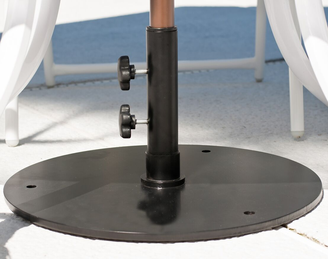 Detail of steel umbrella stand for table use