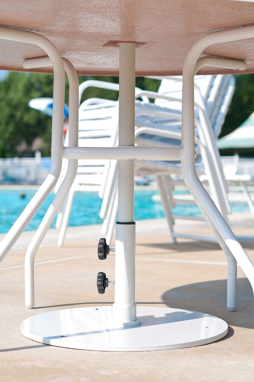 Umbrella stand under pool side table
